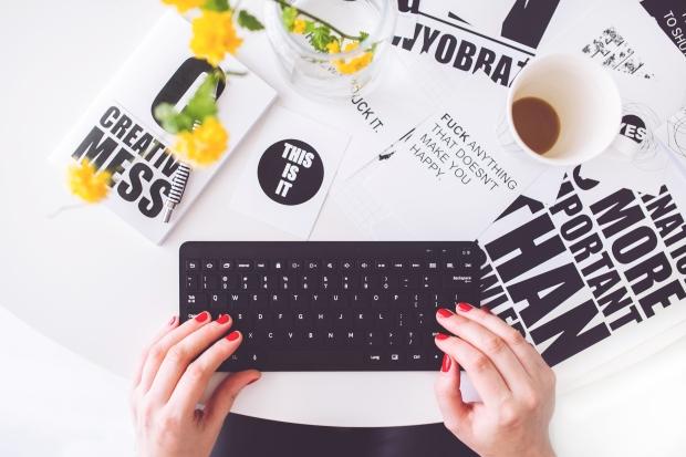 kaboompics-com_girl-writing-on-a-black-keyboard